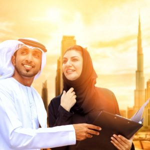 Businessman and businesswoman in front of Burj